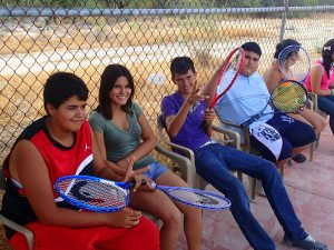 Some of the older kids waiting for their turn to hit. All of them in this picture had never played tennis before.